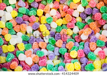 Close up of a bulk food container filled with colorful candy gum drops
