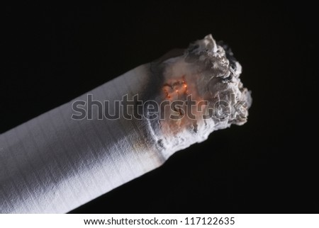 Close-up of a burning cigarette - stock photo