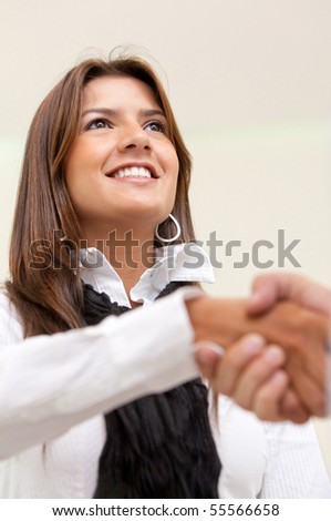 Close up of a business handshake at the office - stock photo