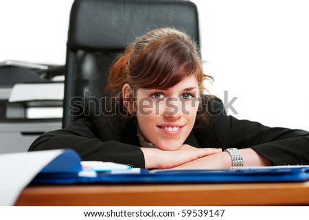 Close-up of a business lady at a  desk with her head resting on her hands