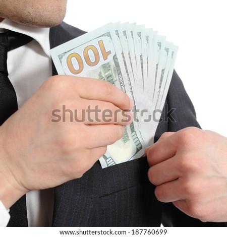 Close up of a business man hand keeping money in his pocket isolated on a white background