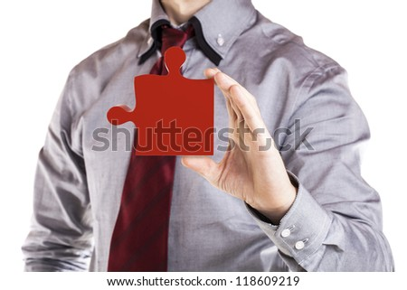 close up of a business man holding a 3d puzzle piece - stock photo