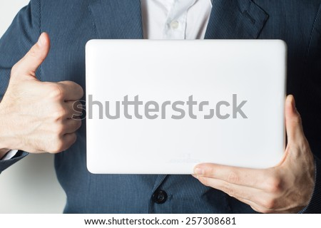 Close up of a business man holding showing whiteboard - stock photo
