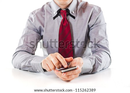 close up of a business man using a mobile phone - stock photo