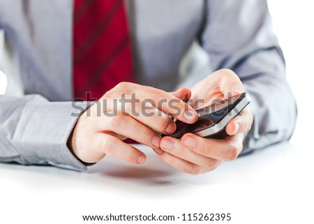 close up of a business man using a mobile phone