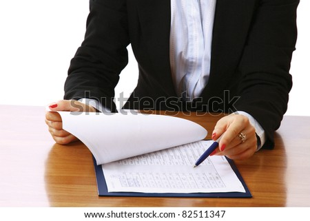 Close-up of a business papers lying in a folder, a woman pointing isolated on white