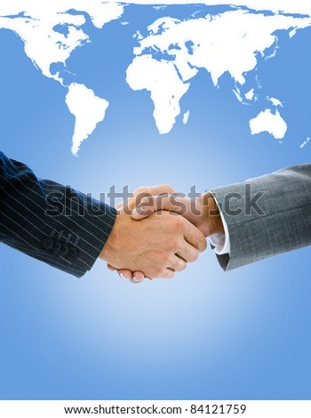 Close-up of a business people shaking hands against a white background - stock photo