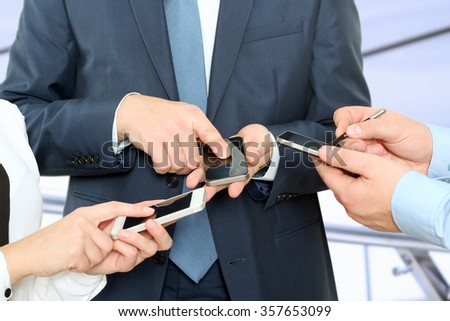 Close up of a business people  using mobile smart phones - stock photo