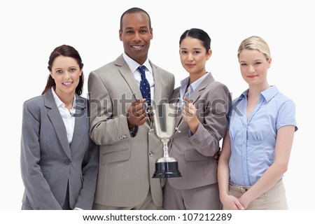 Close-up of a business team holding a cup against white background - stock photo