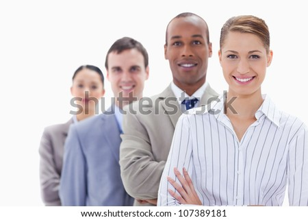 Close-up of a business team smiling in a single line with focus on the first woman - stock photo