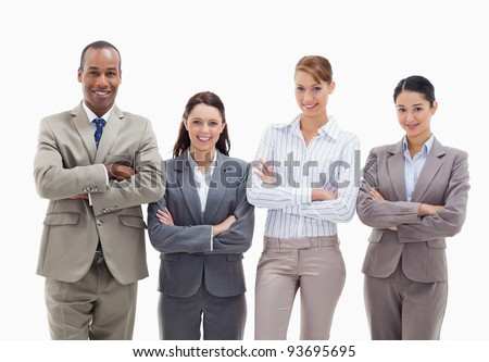 Close-up of a business team smiling side by side and crossing their arms against white background - stock photo