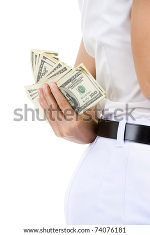 close-up of a business woman hiding money behind her back, isolated on white background - stock photo