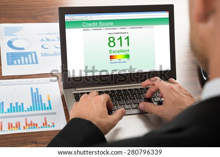 Close-up Of A Businessman Checking Credit Score Online On Laptop - stock photo