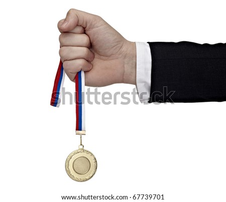close up of a businessman hand holding golden medal on white background with clipping path - stock photo