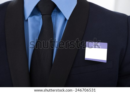 Close-up Of A Businessman In Suit With Blank Identity Card - stock photo