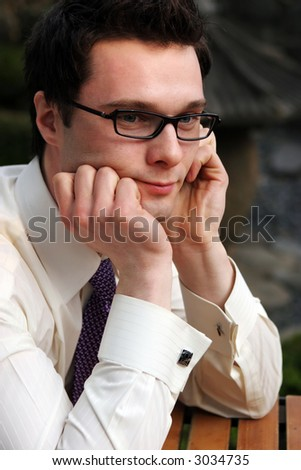 Close-up of a businessman looking sad/reflective/moody - stock photo