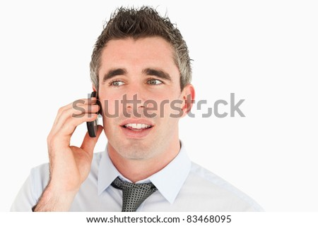 Close up of a businessman making a phone call against a white background