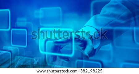 Close-up of a businessman's hand touching visual screen. - stock photo