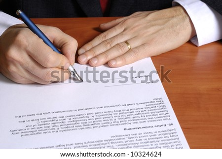 close up of a businessman signing a contract