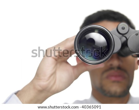 Close up of a businessman with binoculars isolated on white. - stock photo