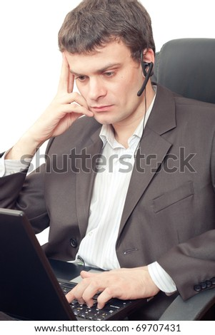 Close Up of a businessman with headset. He is working on laptop - stock photo