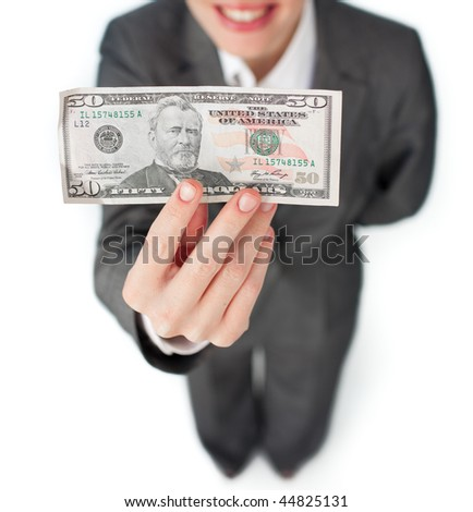 Close-up of a businesswoman holding a bank note against a white background
