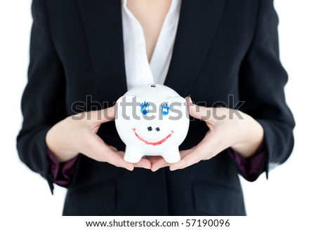 Close-up of a businesswoman holding a piggybank against white background - stock photo