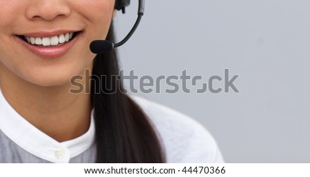 Close-up of a businesswoman using headset at work - stock photo