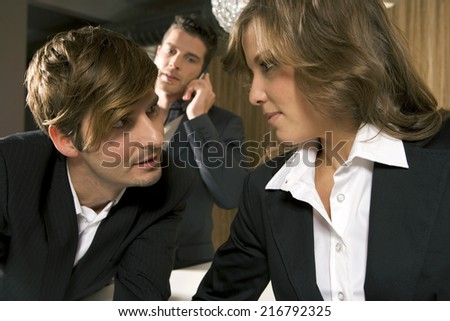 Close-up of a businesswoman with two businessmen