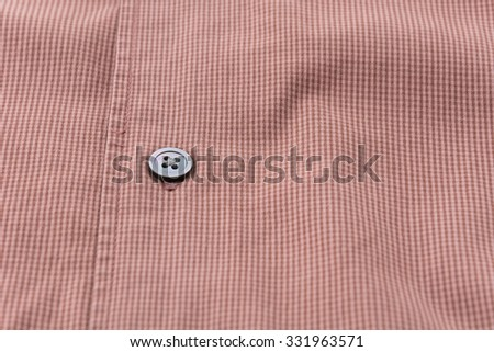 Close up of a button on shirt
