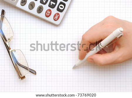 Close up of a calculator, organizer and pen - stock photo
