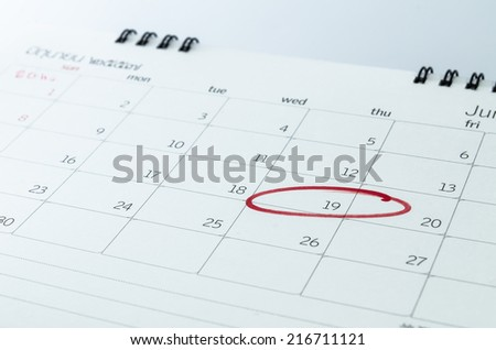 close up of a calendar and a mark - stock photo