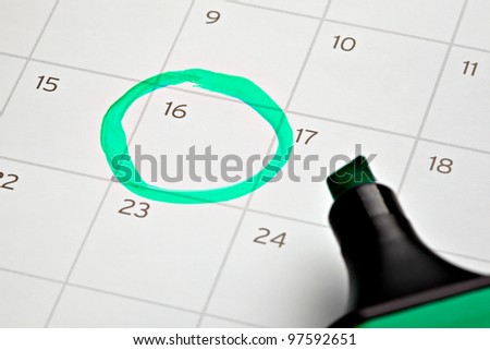 close up of a calendar and a marker