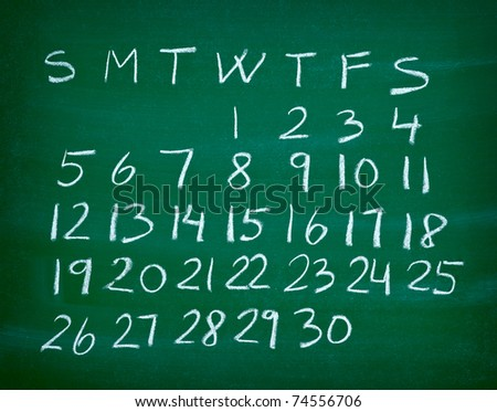 close up of a calendar on a blackboard - stock photo