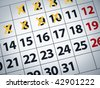 Close up of a calendar with some days crossed off. - stock photo