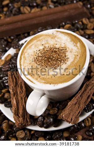 Close up of a cappuccino cup with chocolate. Byrd's-eye shot. - stock photo