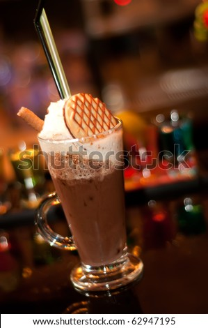 Close up of a cappuccino frappe with chocolate biscuit - stock photo