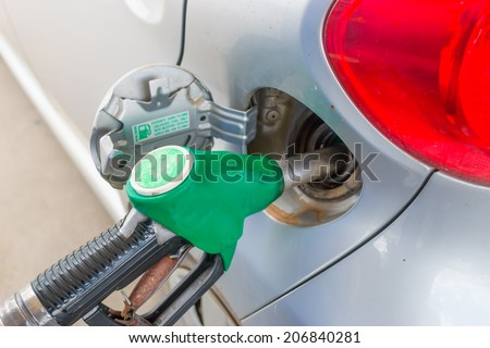 close up of a car refueling - stock photo
