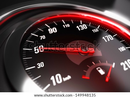 Close up of a car speedometer with the needle pointing fifty Km h, blur effect, conceptual image for safe driving concept