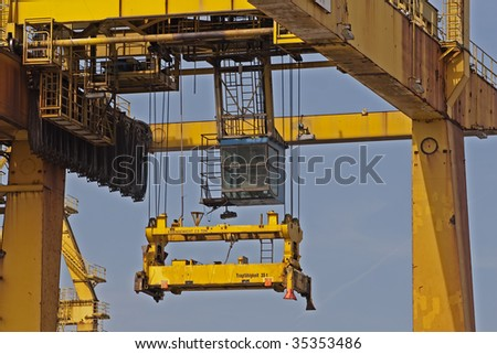 Close up of a cargo container crane at Hamburg(Germany) harbor - stock photo