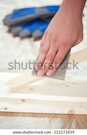 Close-up of a carpenter's hand during work - stock photo