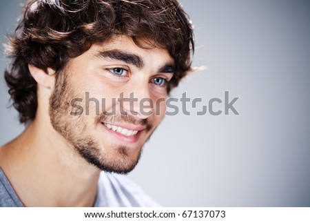 close-up of a caucasian man smiling - stock photo