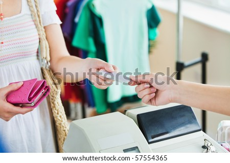 Close-up of a caucasian woman paying with her credit card in a shop - stock photo