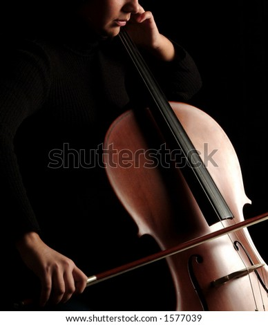 Close up of a cello player - stock photo