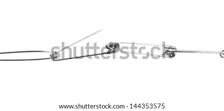 Close-up of a chain of safety pins - stock photo