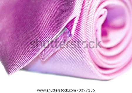 Close-up of a changing pink tie rolling up