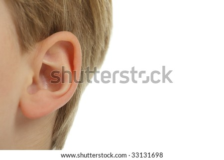 Close-up of a child's ear, isolated on a white background. - stock photo