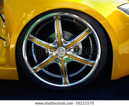 close up of a chromed wheel of tuned car - stock photo