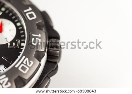 Close up of a chronograph watch on a white background.