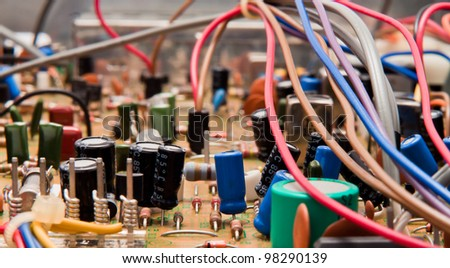 Close up of a circuit board with electrical components and wires - stock photo